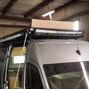 Roof racks with exterior LED lighting