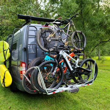 Owl van ladder and tire carrier, and one up bike rack