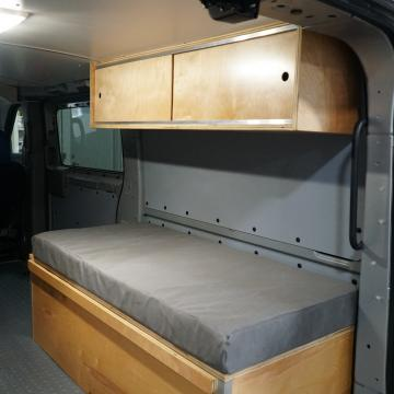 nv2500 camper conversion upper cabinetry and lower bench