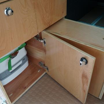 Ram ProMaster custom cabinet toilet storage and step