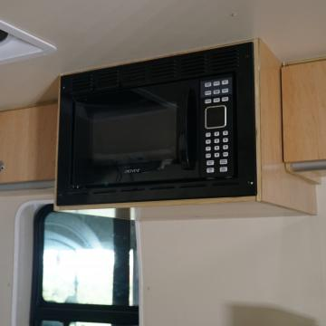 microwave and upper cabinets in place