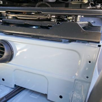 Webasto diesel heater mounted under passenger seat