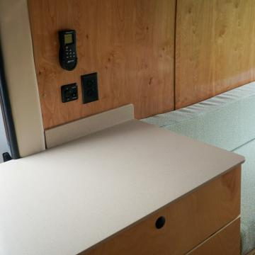 MaxxAir remote and light switch above drawer storage