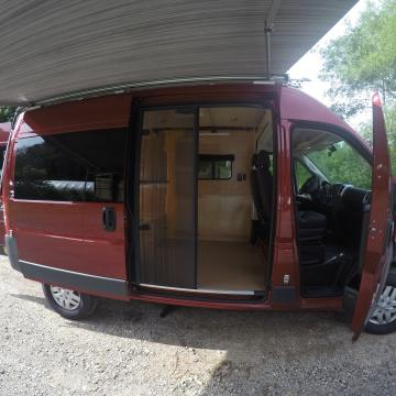 ProMaster conversion with awning and screen door